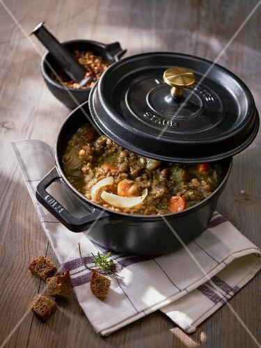 Lentil soup with croutons in a pot