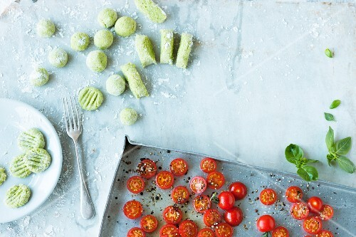 Herb gnocchi with oven roasted tomatoes being made
