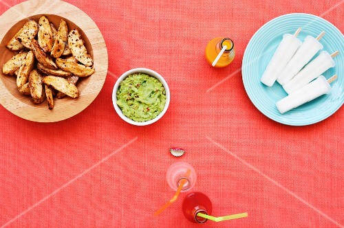 Potato wedges and guacamole with ice lollies