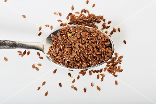 A spoonful of organic flax seeds (seen from above)