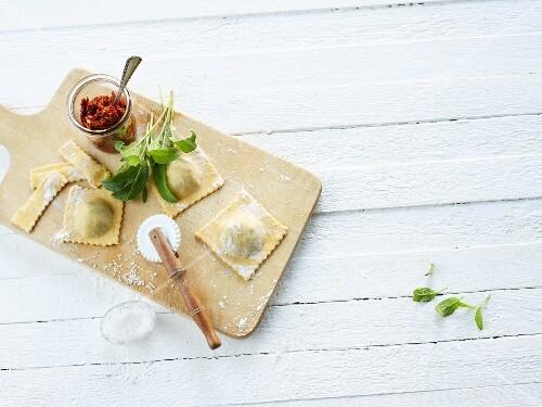 Homemade ravioli on a chopping board