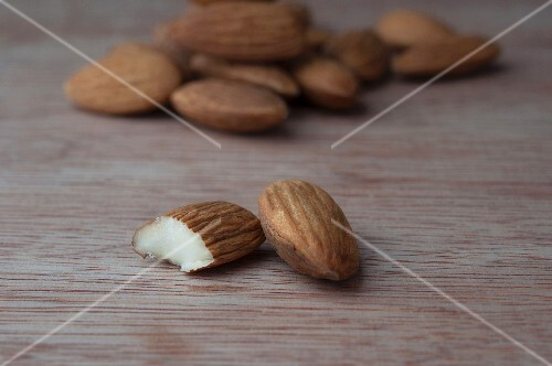 Almonds on a wooden surface