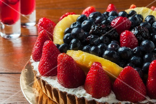 A fruit tart with strawberries and blueberries