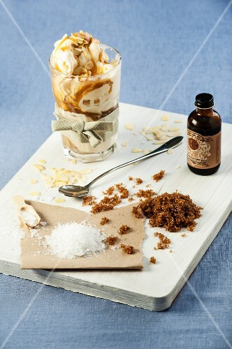 Vanilla ice cream with salted caramel sauce and slivered almonds