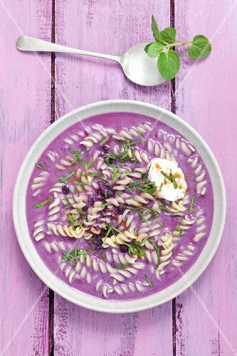 Blueberry soup with mascarpone, pasta and peppermint