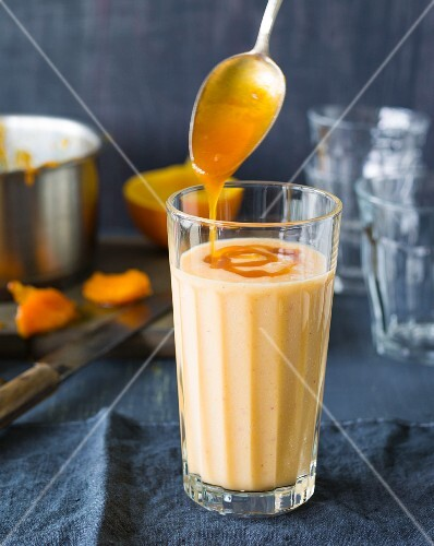 An apricot smoothie made with buttermilk and cinnamon