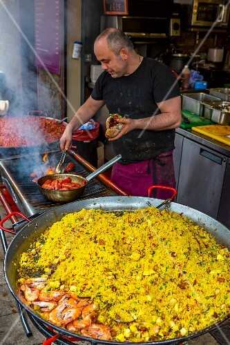 Paella being made (Borough Market, London, UK)