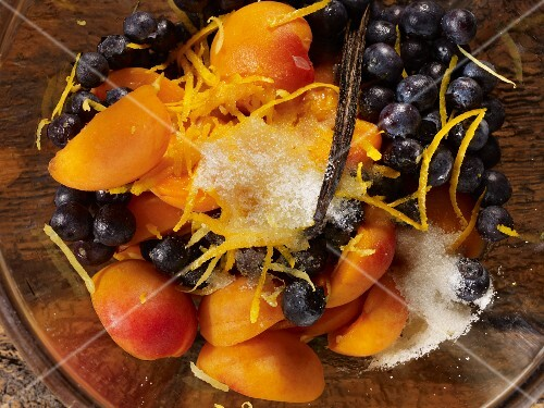 Apricots and blueberries with sugar, lemon zest and vanilla pods