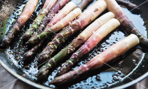 Asparagus frying in a pan