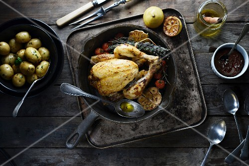Roast chicken with garlic and potatoes