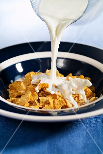 Milk being poured over cornflakes