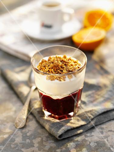 Yogurt muesli, espresso and oranges