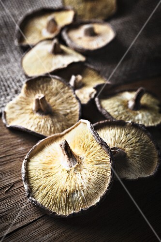 Dried shiitake mushrooms on a wooden surface