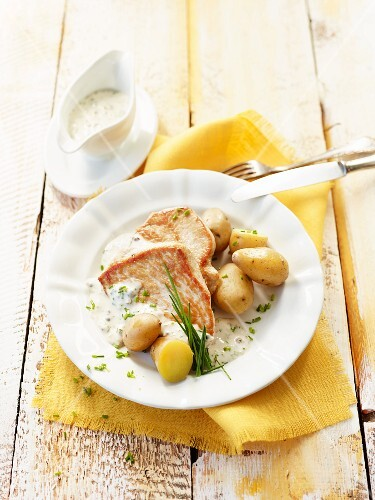 Peppered turkey steak with a chive sauce and potatoes
