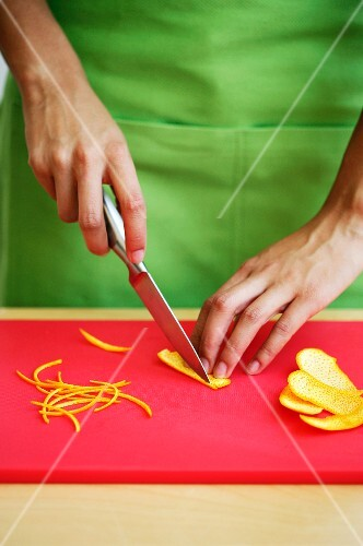 Orange zest being sliced