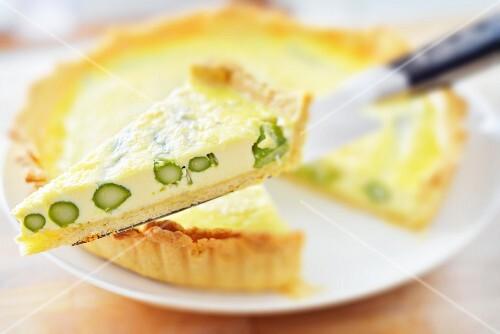 Asparagus tart, one slice on a cake server