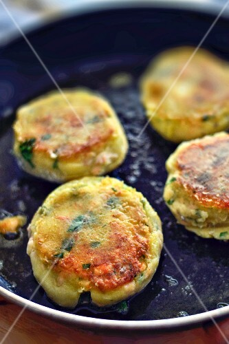 Salmon cakes in a pan