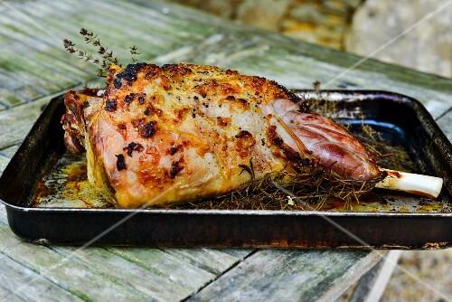 Roast leg of lamb with rosemary in a roasting tin