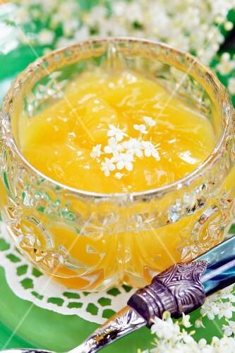 Lemon curd with elderflowers in a crystal bowl