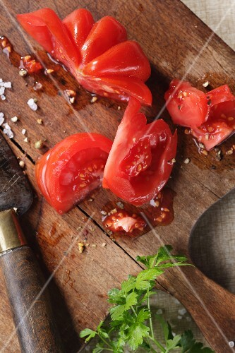 Sliced beefsteak tomatoes on a wooden board