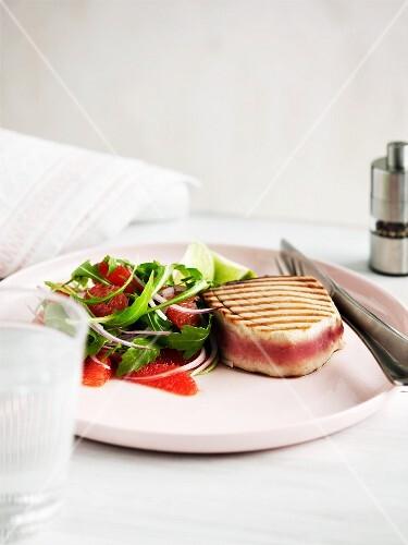 Grilled tuna fish steak with grapefruit salad