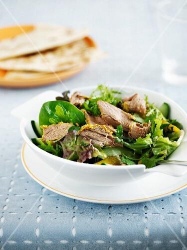 Mixed leaf salad with tandoori lamb