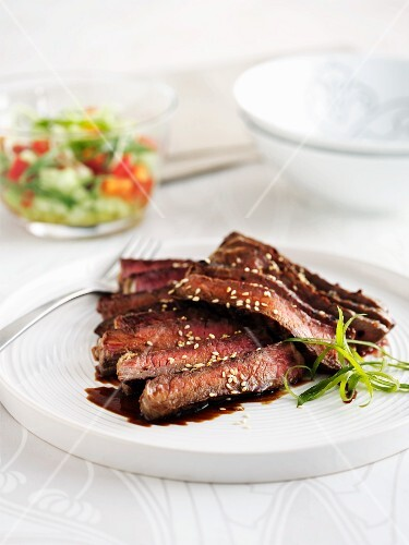 Beef teriyaki with a cucumber salad