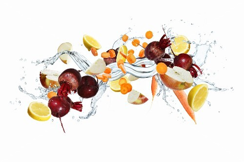 Fruit and vegetables with a splash of water