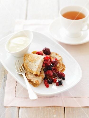 Buckwheat pancakes with berries and a cup of tea