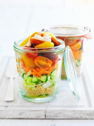 Couscous and vegetable salad in jars