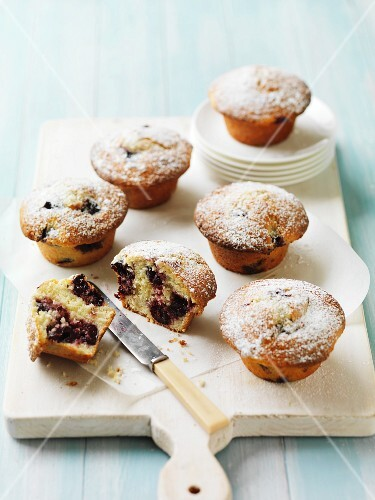 Cherry muffins with icing sugar