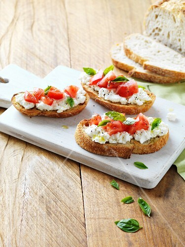 Bruschetta topped with cottage cheese and tomatoes