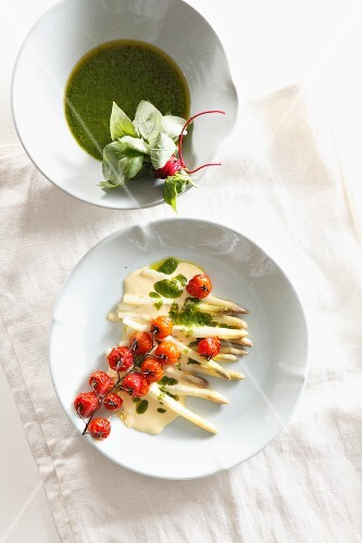 Asparagus with Hollandaise sauce, roasted tomatoes and basil and lemon oil