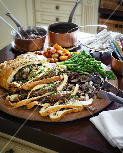 Leg of lamb wrapped in bread with vegetables