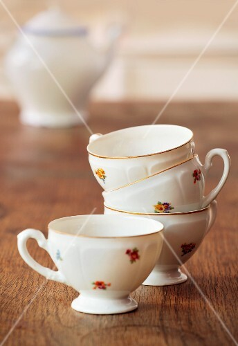 A stack of floral-patterned tea cups