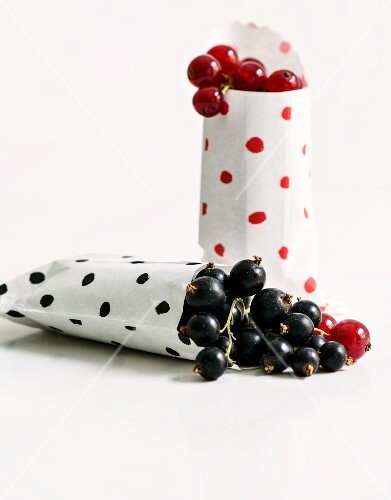 Blackcurrants and redcurrants in paper bags