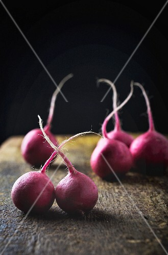 Radishes on a wooden surface