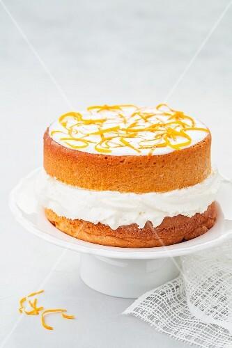 An orange cake with cream