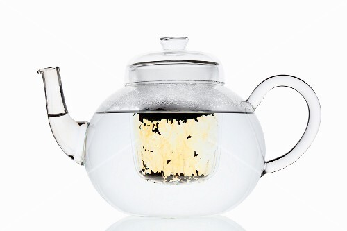 Water in a glass teapot with a filter