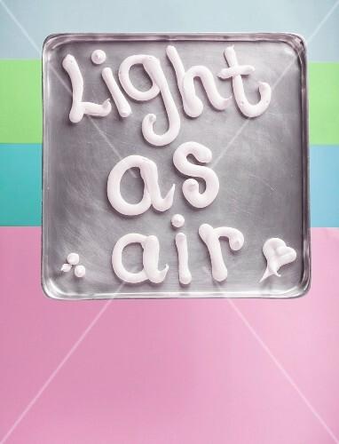 Meringue words on a metal tray