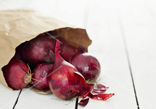 Red onions in a paper bag