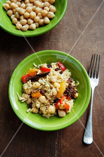 Couscous with chickpeas, read peppers, raisins, dried apricots, cinnamon and star anise (Morocco)