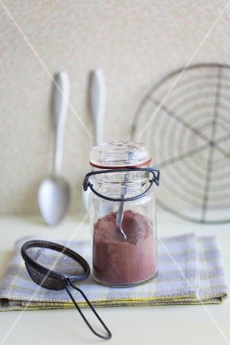 A jar of cocoa powder