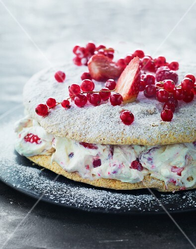 A strawberry and redcurrant cake with mascarpone cream