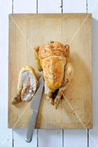 Roast chicken being carved