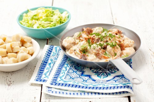 Chicken dumplings in a chanterelle mushroom sauce with gnocchi and cabbage salad