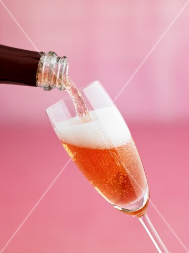 Pouring a glass of rosé sparkling wine