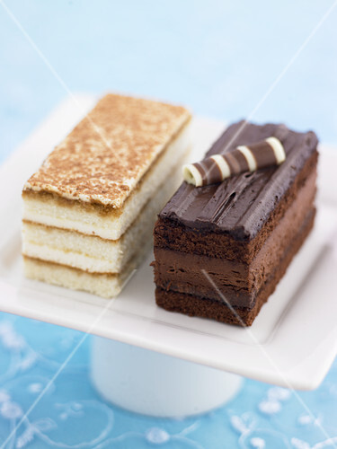 A tiramisu slice and a chocolate slice