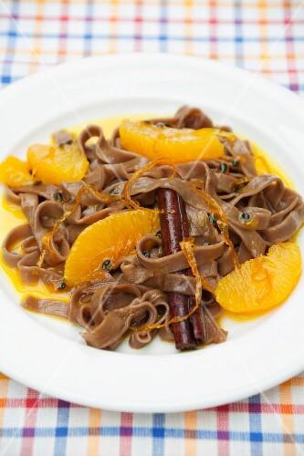 Chocolate pasta in orange sauce