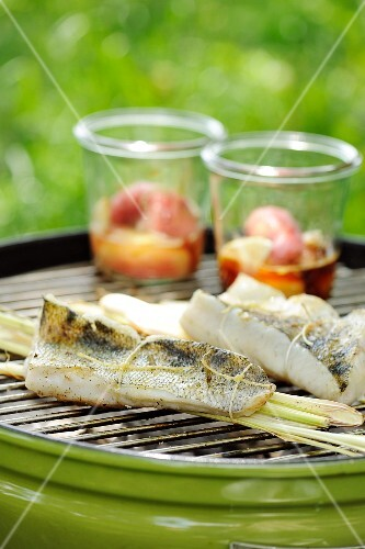 Zander and lemongrass parcels on a barbecue